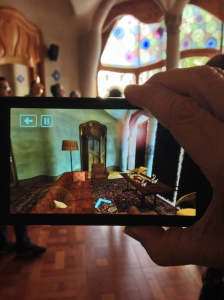 A view of what the room looked like when Gaudi designed it...through the Smartphone they use as a tour device
